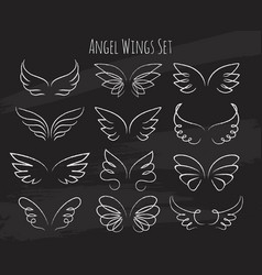 Hand drawn angel wings on chalkboard vector