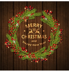 Christmas wreath with red berries and fir branches vector image