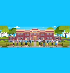 Group of diverse pupils in front of school vector