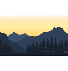 Silhouette of mountain and orange background vector