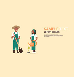Couple farmers planting tree man with shovel woman vector