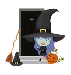 Cute little girl with witch costume in house door vector