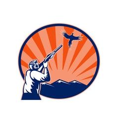 Hunter aiming shotgun rifle at bird pheasant vector image