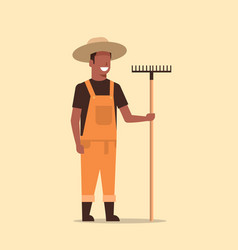 Gardener holding rake african american country man vector