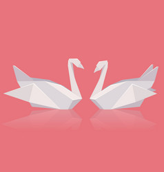 A pair of paper origami swans vector