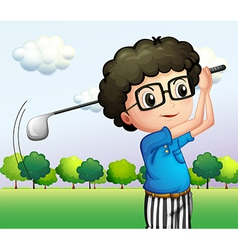 A boy with glasses playing golf vector