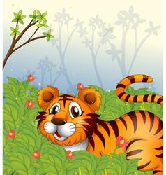 A tiger in the dark forest vector image
