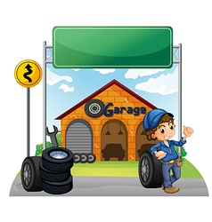 A boy standing beside a wheel outside the garage vector image vector image