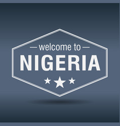 welcome to nigeria hexagonal white vintage label vector image