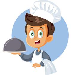 cute little chef boy holding cloche platter vector image