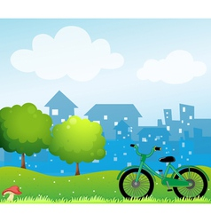 A bicycle in front of the village vector