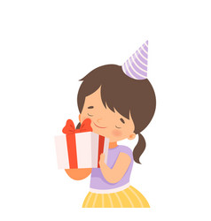 Cheerful little girl wearing birthday hat holding vector