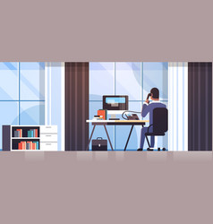 Businessman sitting at workplace desk rear view vector