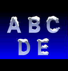 A b c d e letters with snow caps vector