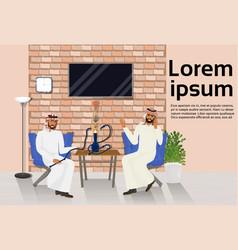 Two arab men smoking hookah sitting at table vector