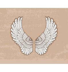 Pair of white wings in vintage style vector