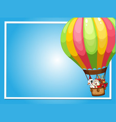 Border template with santa flying in balloon vector