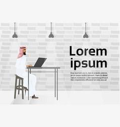 Arab business man working at laptop computer vector