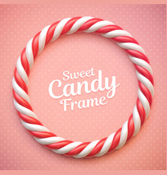 Andy cane circle frame on polka dot background vector