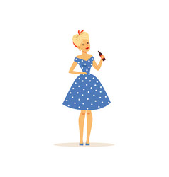 Beautiful young woman in a blue polka dot dress vector