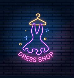 dress shop neon light sign on dark brick wall vector image