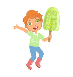 smiling boy holding a big green fruit ice cream a vector image