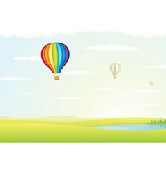 Hot Air Balloon over Green Fields Image vector image
