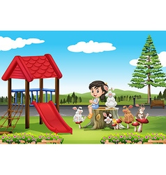Girl and rabbits in the playground vector