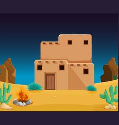 An adobe house at desert vector
