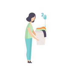 young woman holding basket with old clothes vector image