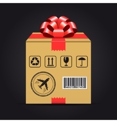 Shipping cardboard box with red bow vector image