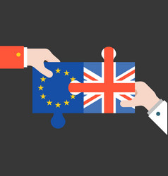 Hand holding britain and euro jigsaw puzzle vector