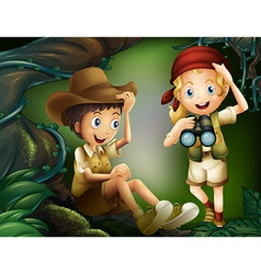 A jungle with a boy and a girl vector