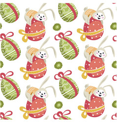 Easter bunny sitting on decorative egg seamless vector