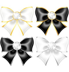 White and black bows with diamonds and gold edging vector image vector image
