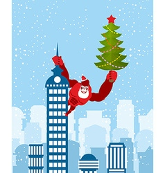 Big red gorilla dressed as santa claus climbs the vector