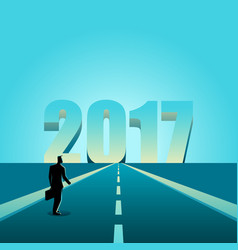 Businessman walking towards the year 2017 vector