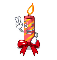 Two finger cartoon christmas candles on a table vector