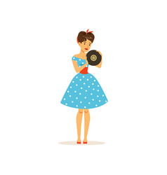 beautiful young woman in a blue polka dot dress vector image vector image