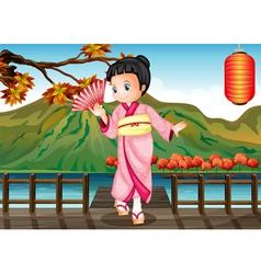 A girl in kimono attire at the bridge vector