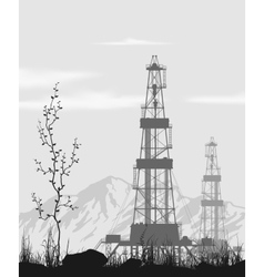 Oil rigs over mountain range vector image