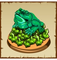 One frog figurine sitting on emerald vector