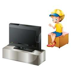 A boy watching TV vector image