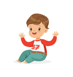 Cute smiling little boy dressed in jeans and vector