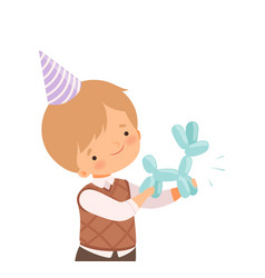 Little boy wearing birthday hat holding animal vector