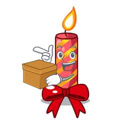With box cartoon christmas candles on a table vector