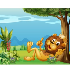 A king lion relaxing under a big tree vector