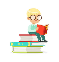 Smart boy sitting on pile of books and reading a vector