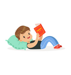 cute little boy lying on a pillow and reading a vector image vector image