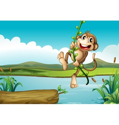 A cheerful monkey playing with the vine plant vector image